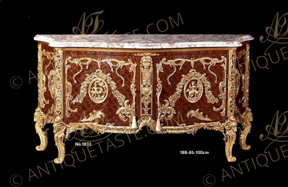 A French late 19th century Louis XV style gilt-ormolu-mounted and veneer parquetry inlaid commode a vantaux after the model Commode Médaillier designed by the Slodtz brothers and executed by Antoine-Robert Gaudreaux, made for le cabinet du Roi at Versailles with a serpentine veined moulded marble top above a pair of doors with one tier inside, each door centered by an ormolu oval one with a cherub and goat, the other oval with Ariadne on a leopard, all within marvelously chiseled  ribbon-tied acanthus leaves and blossoming flower swaging  garlands, all on a diamond parquetry ground veneer inlay centered by an ormolu female mask on scrolling ormolu works and shell on a very fine ormolu scalloped shell form apron with acanthus leaves scrolls, the sides each with a further similar oval medallion within the same ormolu tied scrolling frame, and raised on astonishingly chiseled and burnished ormolu cabriole legs with scrolled ram-headed capitals, The original precious commode-médaillier was designed and created in 1739 for the king's use in Louis XV's Cabinet à Pans at Versailles. It is now in the Cabinet des Médailles at the Bibliothèque Nationale, This commode is based on the famous kingwood medal cabinet supplied by the Royal cabinet-maker Antoine-Robert Gaudreaus (1682-1746) on 10 January 1739 for the Cabinet Interieur. It was referred to at the time as 'Par les Srs Gaudreaux ébéniste et Slodtz frères, sculpteurs, pour servir dans le cabinet aux tableaux avant la petite galerie à Versailles '. The bronze mounts were modelled by the Slodtz brothers. The commode was a popular model amongst Parisian makers during the second half of the 19th century and many variants of it were made