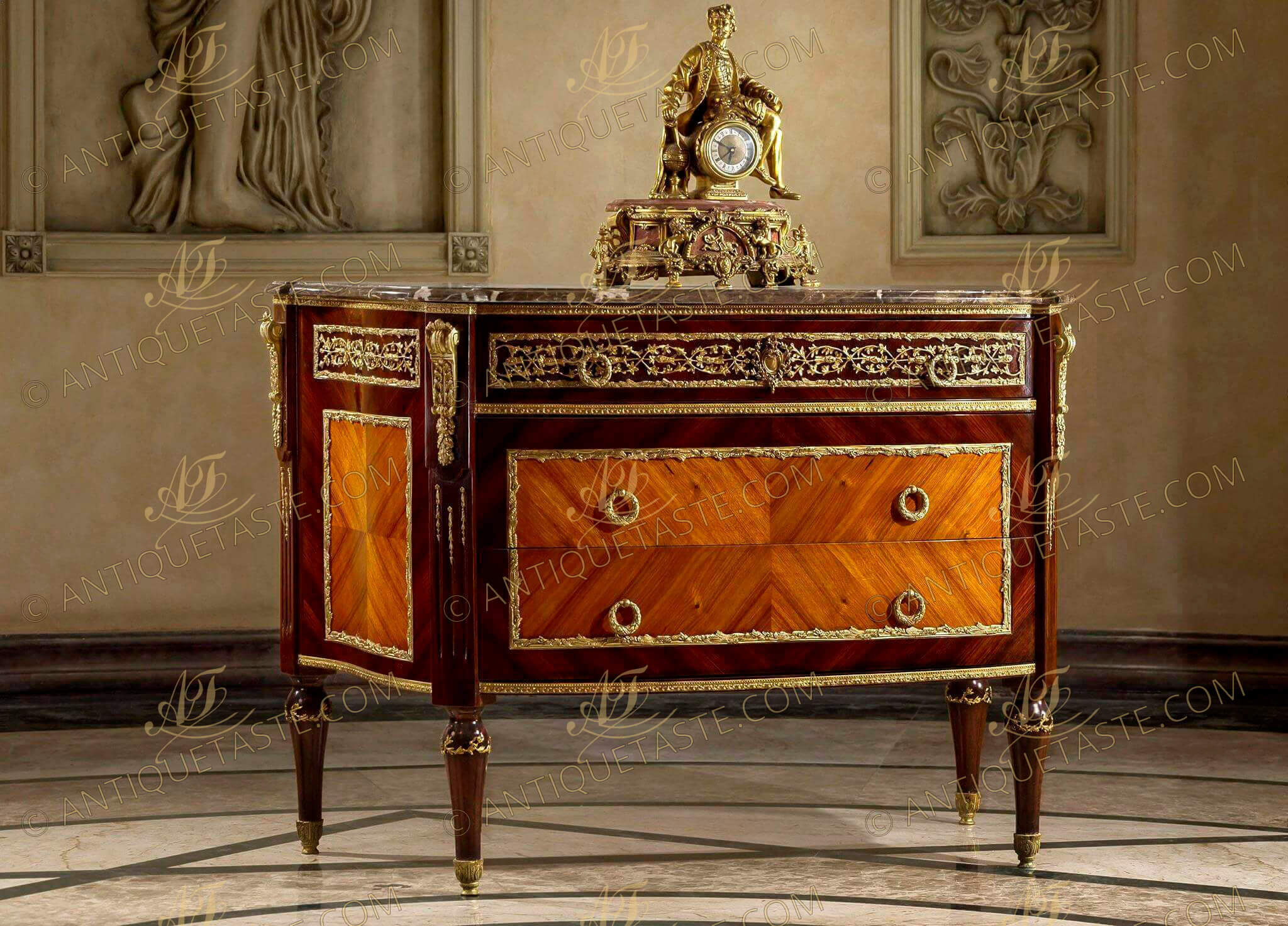 A Louis XVI style gilt-ormolu mounted quarter veneered commode after the model by Jean-Francois Leleu and François Linke Paris, circa 1900 Of D form surmounted by a fine veined eared marble top, above a panelled ormolu-vine-mounted frieze drawer, and boxwood stringing above a pair of quarter-veneered panelled drawers with reeded ring handles all within fine foliage ormolu encadrement, the fluted angles ornamented with ormolu floral chandelles and headed with scrolled acanthus and oak-leaf clasped volutes, on ormolu ornamented circular tapering legs terminating in acanthus-capped feet