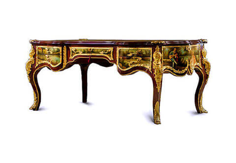 French 19th century Louis XV and Vernis Martin style ormolu-mounted veneer inlaid Executive decorative Bureau Plat, the scalloped surface with moulded border cornered at the four angles with gilt ormolu foliate lyre and seashell shaped cast clasps and three sectional scalloped gilt-tooled leather top, the frieze below has five drawers, with delicate foliate handles, and all bordered with intricately chiseled foliate ormolu trims, the central recessed drawer with foliate ormolu keyhole escutcheons. On each side of the central drawer, vertical acanthus gadroon shaped ormolu chutes elongated with ormolu fillet wrapping around the contour of the whole desk, at each corner extraordinary and richly chiseled large gilt-ormolu female figure chutes adorned with scrolls and a feather headdress, the sides with finely ornamented with foliate scrolled ormolu encadrements terminated with C shapes harmonized with the scalloped apron below, the drawers, the sides and the back are beautifully hand painted by our artisans with romantic court scenes and outdoor natural landscapes on the François Boucher manner, the desk is raised on four bold cabriole legs with exquisitely chased ormolu leafy paw sabots