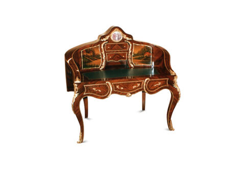 A French Louis XV and Vernis Martin style revival ormolu-mounted, sans traverse veneer inlaid and porcelain plate desk after the model by Theodore Millet circa 1880, The upper curved structure centered with a porcelain plate representing a court scene encircled with an ormolu border, surmounted and flanked with ormolu festoons, The superstructure is fitted with two doors to each side hand painted on the Vernis Martin style with outdoor scenes, with ormolu borders and pulls flanking two ormolu bordered drawers and one compartment, separated from the doors with two ormolu foliate pierced S shaped gadroons, The curved sides terminating with foliate ormolu clasps housing the gilt-tooled leather writing surface, above the serpentine shaped frieze with three drawers, The drawers are inlaid with sans traverse veneer inlays, ormolu border and foliate ormolu handles, the central drawers frieze with an ormolu shell, the two side drawers flanked with foliate C scroll ormolu gadroon, the frieze lower part contour of the desk is decorated with hammered ormolu filet extends to the internal side of the legs, The desk is raised on four cabriole legs ornate with fine ormolu acanthus chutes and pierced foliate ormolu turned acanthus sabots, The convex sides connected to the back and stunningly inlaid with sans traverse palisander veneer inlaid and cut veneer filet, The serpentine top ornamented with a foliate ormolu mount above a scalloped ormolu bordered part inset with a hand painting on the Vernis Martin style representing an outdoor nature scene, The lower section has a cut veneer medallion centered with a porcelain plate encircled in a foliate ormolu crowned border flanked with two faux drawers cut veneer sections decorated with two ormolu garlands