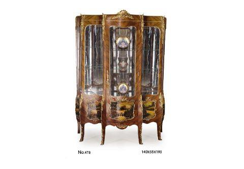 A palatlial Louis XV, and Vernis Martin style, ormolu-mounted veneer inlaid Grand Vitrine, on the manner of Francois Linke, Grande vitrine, Louis XV 3 corps bois de violette Panneaux Vernis Martin, The quarter sans traverse veneered shaped top apron crested with an astonishingly chiseled ormolu shell cabochon issuing two wreath branches on the protruding central three-quarter length glazed door, Exquisitely crafted four ormolu female busts chutes on each top corner surmounted with scrolled acanthus branches and four acanthus ormolu mount chutes on the lower quarter extending on the cabriole slender splayed legs with foliate ormolu filet to the scrolled ormolu sabots, The lower quarter with five Vernis Martin harmonious outdoor panels within scrolled ormolu borders