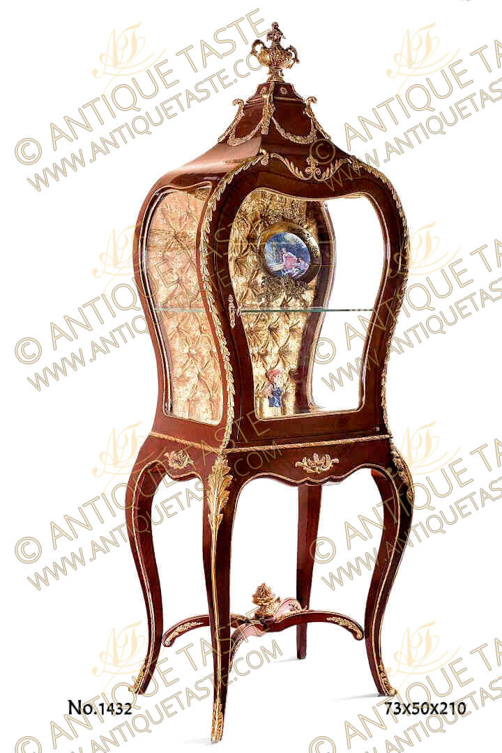 French ormolu mounted Serre-Bijoux after the model by François Linke and Léon Messagé, Circa 1904. Paris. The domed top with scrolling acanthus and reeds to the angles and surmounted by an engraved ormolu urn, above shaped bombé glazed sides ornamented with ormolu laurel wreath, the front with a door, the capitone golden velvet-lined interior with one glass shelves, on shaped tapering legs alternately headed by ormolu acanthus leaves, joined by a scrolled X shaped stretcher surmounted by a flower filled urn, on scrolled foliate cast sabots